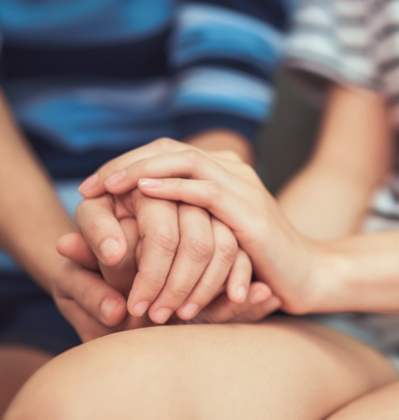comforting the other person by holding hands